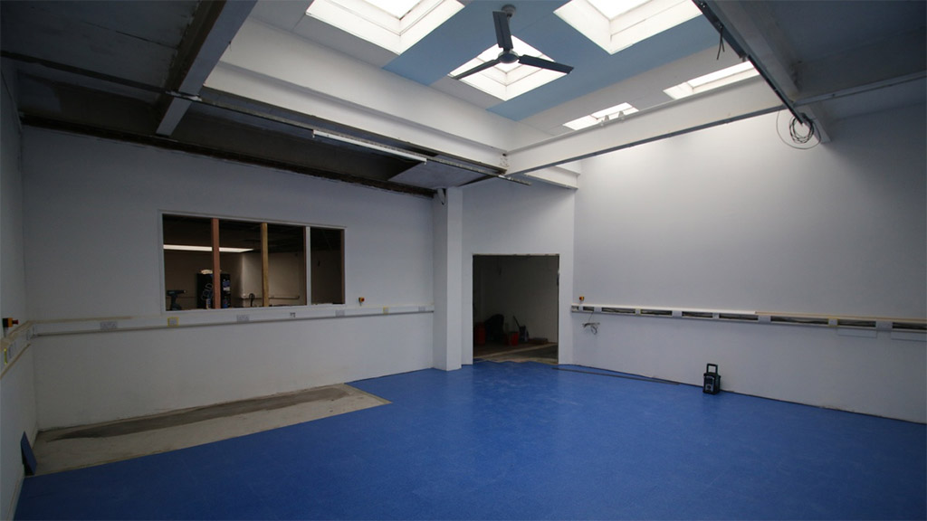 Blue workshop floor, with blue roof and ceiling fan